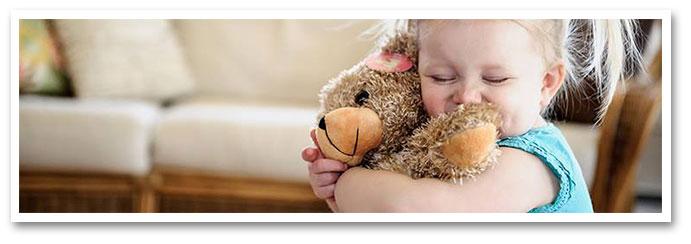 Young girl hugging heartbeat bear